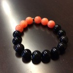 brown boy bad(?) bracelet with onyx and orange jade beads