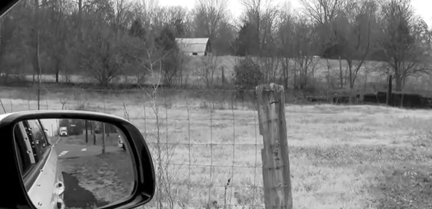 Photo of rear view mirror, black and white, for Brown Boy Bad